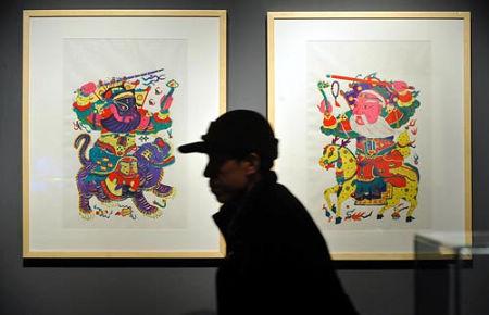两位桃花坞年画传承艺人房志达和叶宝芬